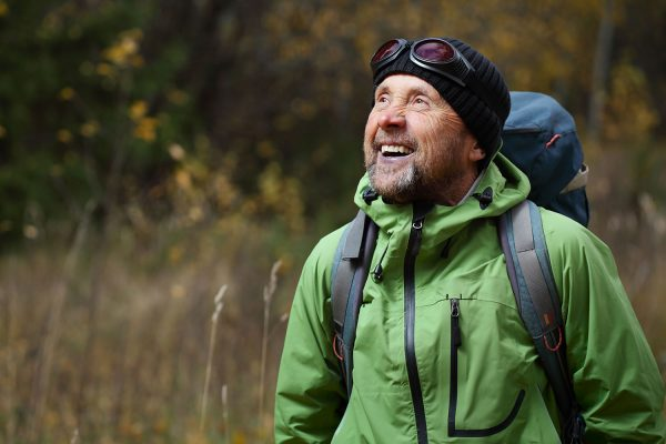 male hiker smiling
